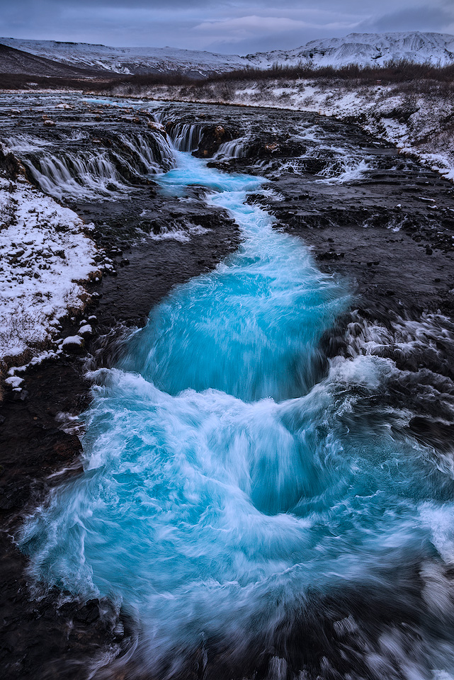 River Bruara turns into the waterfall coloured in fantastic blue, Bruarfoss