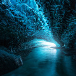 A view inside of an Ice Cave with blue glassy ice roof, Vatnajokull, Iceland