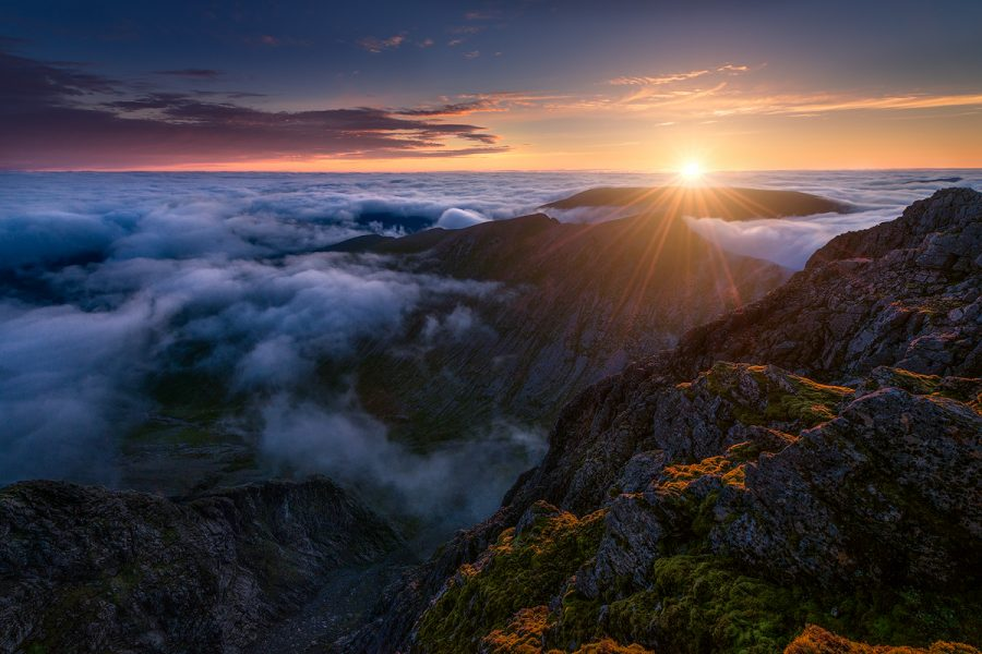 Sunrise above sea of clouds seen here from Ben Nevis