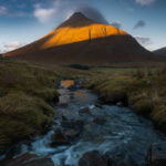 The last rays of setting sun highlight the steep slopes of Beinn Dorain