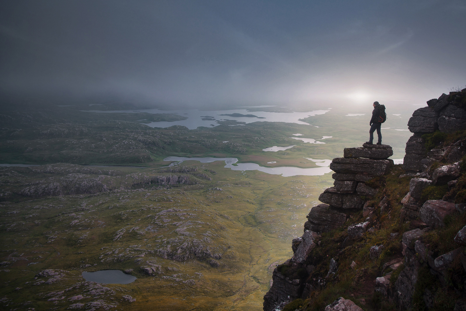 Hiker a top of Suilven