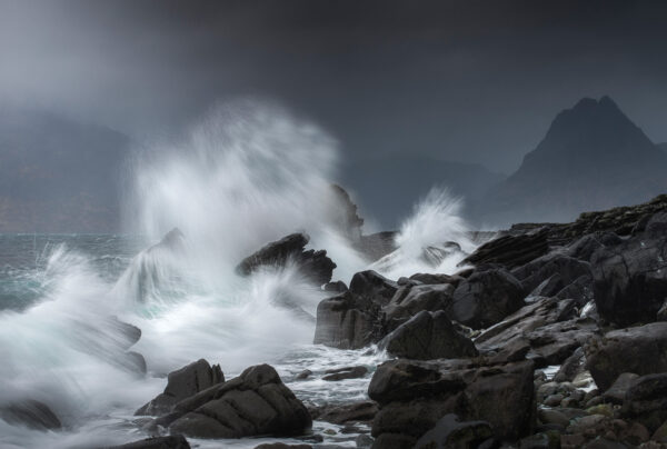 Fury waves splashing against the rocks in Elgol