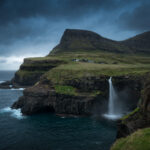 Stormy evening over the iconic Gásadalur village and Múlafossur waterfall