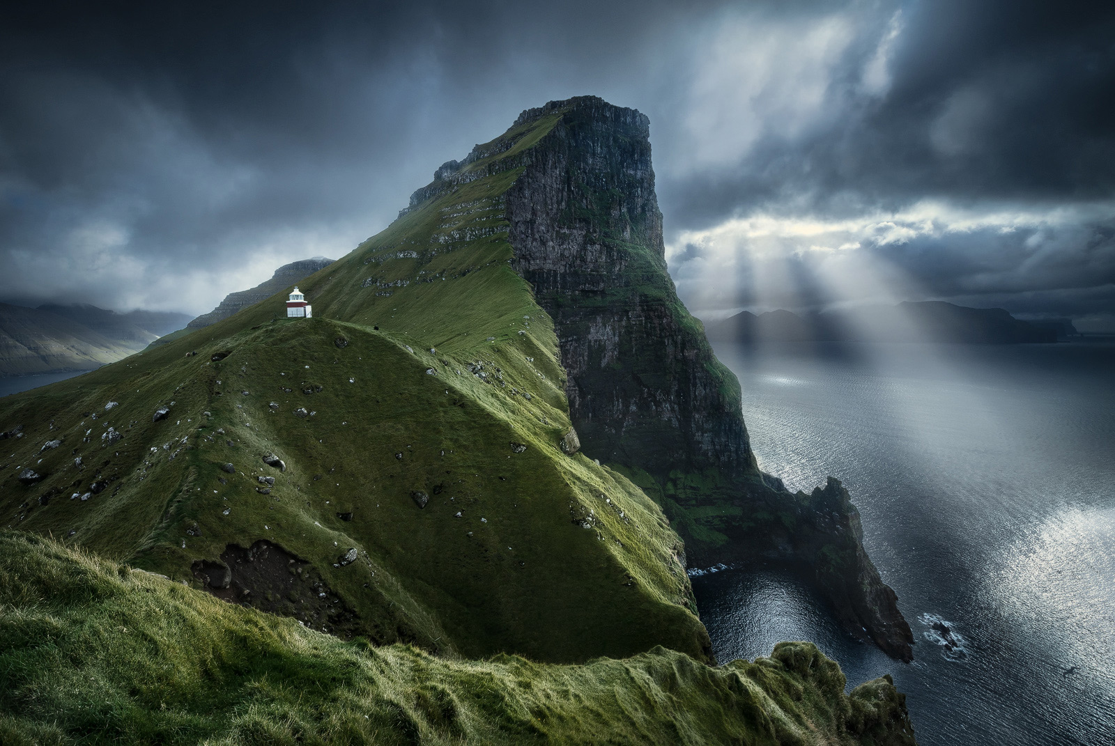 Kallur Lighthouse seems to be a tiny toy against 537m high cliff at the northernmost point on the Kalsoy Island